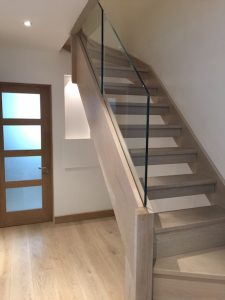 open tread stained oak staircase with modern frameless glass