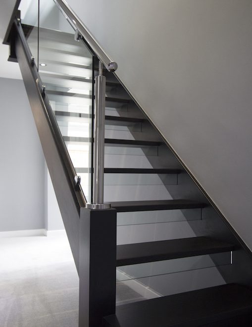 With a trailblazing and highly specific design brief, this new flight pairs bewitching black stained oak with pristine stainless steel baluster posts and rails to house our 10mm toughened glass. Combining oak, steel and glass delivered an ultra-modern staircase synergy and left mediocrity far behind.