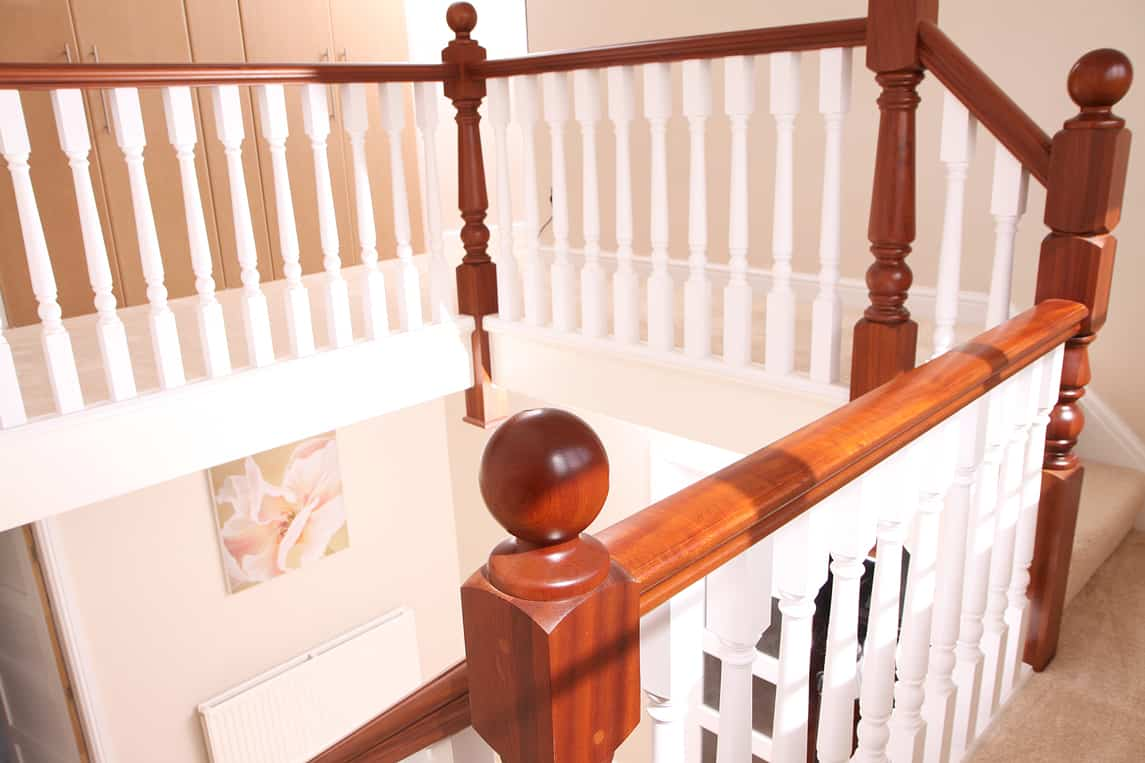 Vintage style with sapele posts and rails and elegant white turned spindles