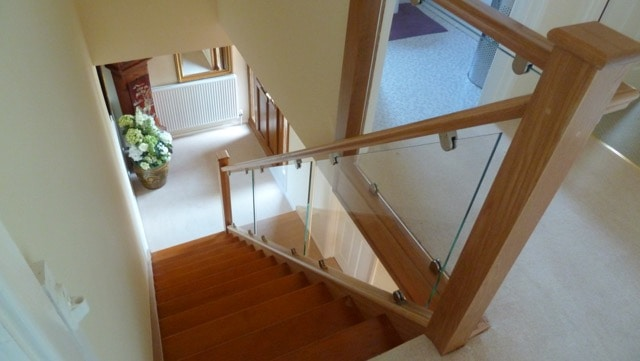 Oak with clamped glass balustrade